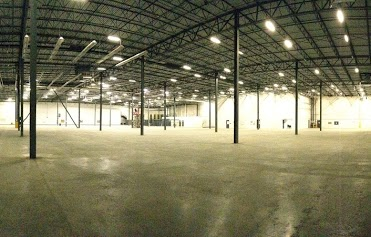 empty warehouse - showing the warehouse floor, columns, trusses and roof
