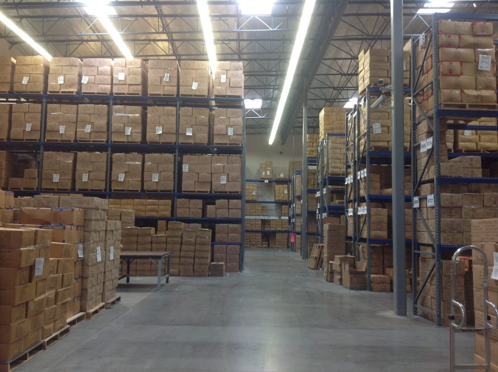 warehouse with racking and pallets stored in shelving