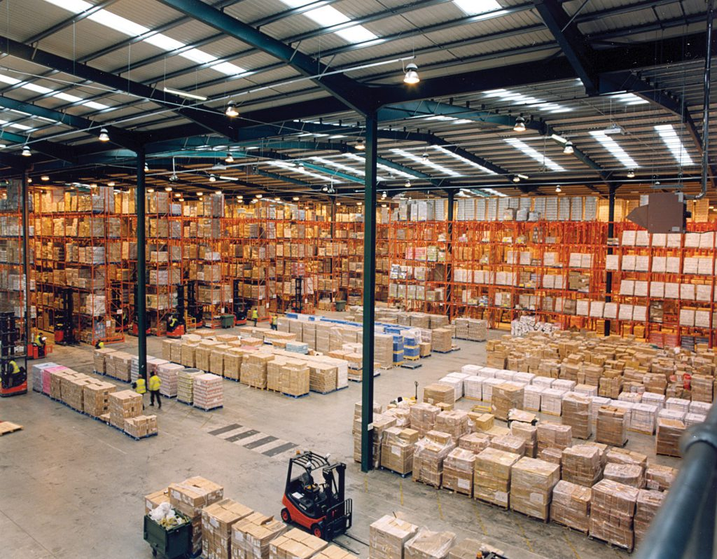 Warehouse with pallet racking and shelving - forklift moving pallets