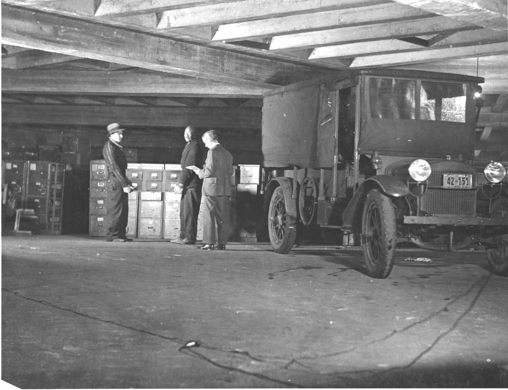 Vintage photo of pallets being loading into a truck - lumping freight unloading service