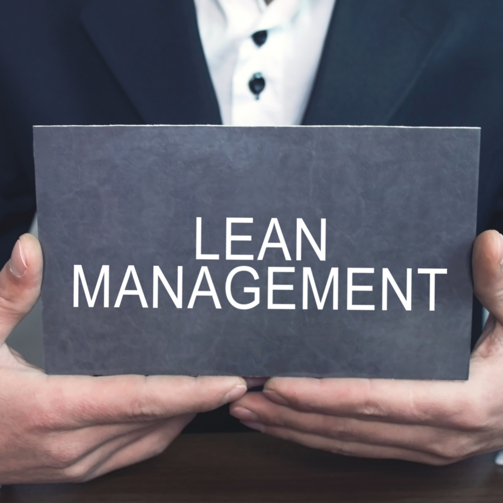 Man holding lean management sign