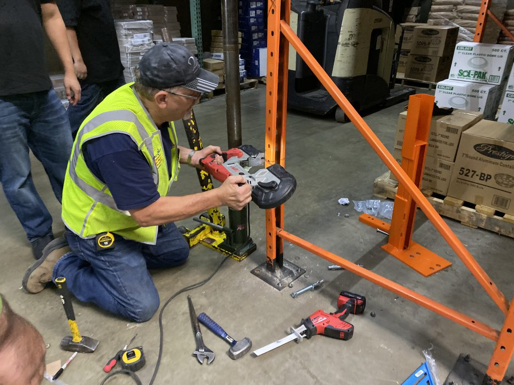 Rack installers cutting rack in order to repair pallet racking