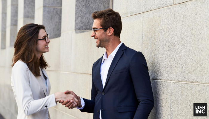 PROPINQUITY - CLOSENESS OF TWO BUSINESS PROFESSIONALS SHAKING HANDS