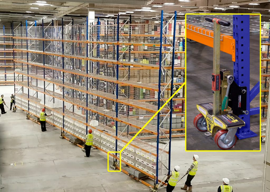 a team of men working to move rack in a warehouse