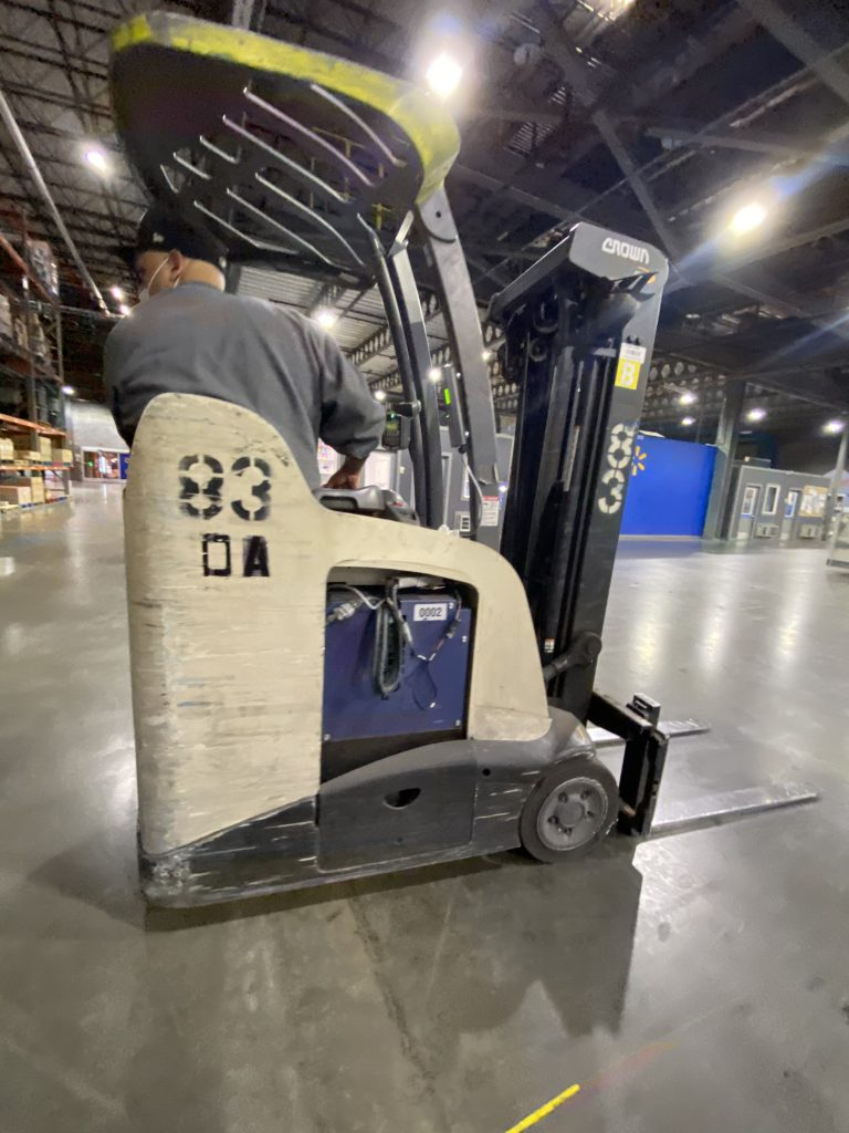 Man driving a forklift powered by a fuel cell