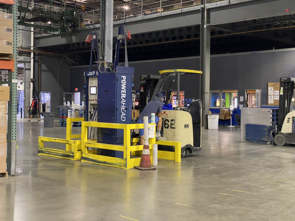 man refueling a forklift fuel cell