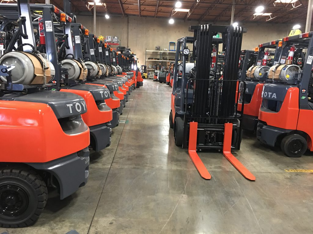 propane forklifts parked in a row