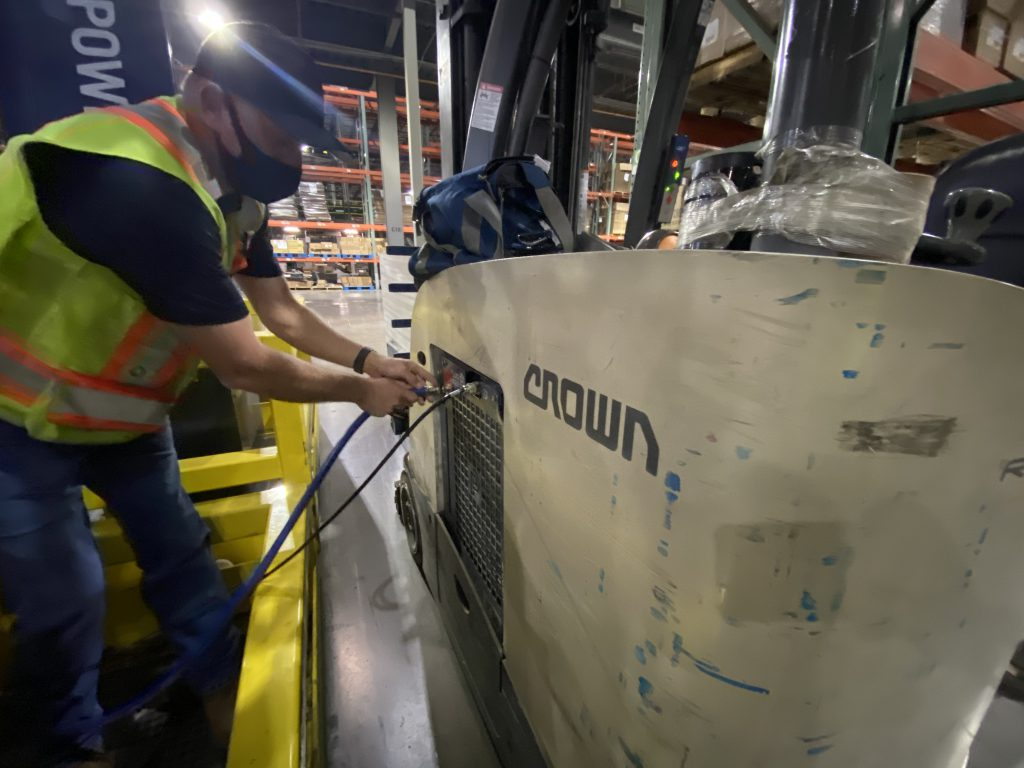 Forklift fuel cell being fueled with hydrogen